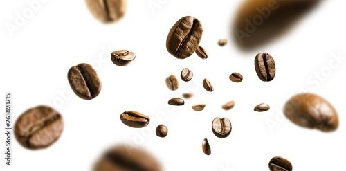 Obraz na plátne Coffee beans in flight on white background