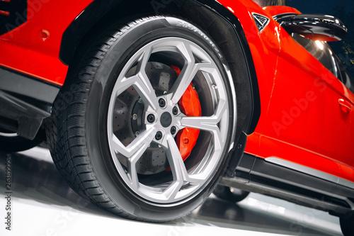 фотография Car braking system. Sport car front wheel brake