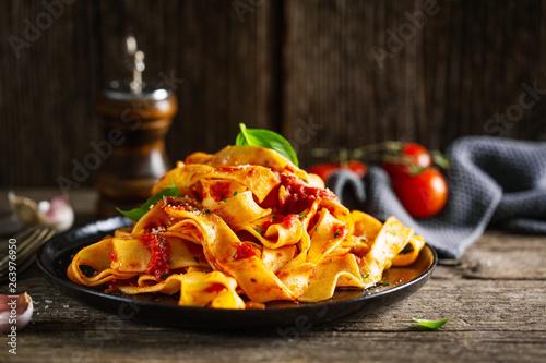 Fototapeta Tasty italian pizza with tomato sauce and parmesan