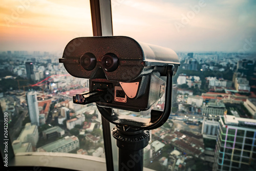 observation deck on a tall building with large binoculars to observe the beautiful panorama of Saigon or Ho Chi Minh city Fototapeta