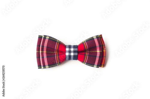 red checkered bow tie on a white background Fototapeta