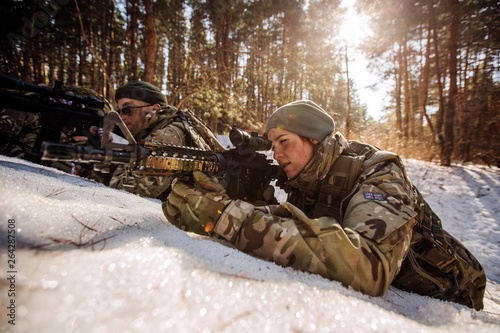 team of special forces weapons in cold forest Fotobehang