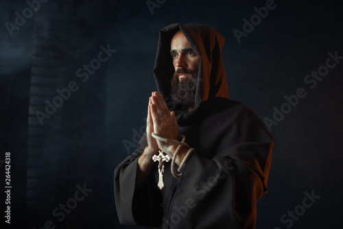 Fotografie, Obraz Medieval monk praying with closed eyes