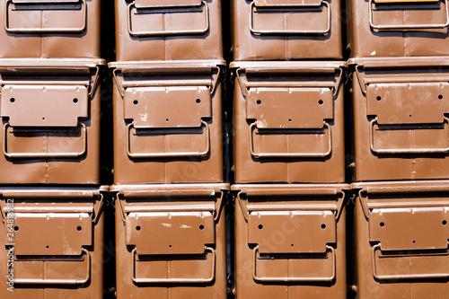 Fotografiet Stacked brown ammunition boxes designed for the safe transportation of bullets,
