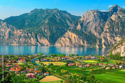 Fotografie, Obraz Fantastic Torbole cityscape with plantations and lake Garda, Italy, Europe