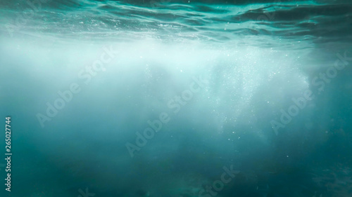 Abstract image of lots of bubbles floating in clear turqouise sesa water