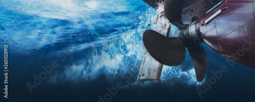 Fotografie, Obraz Propeller and rudder of big ship underway view from underwater