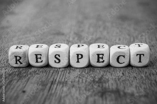 Canvas Print Closeup of word on wooden cube on wooden desk background concept - Respect