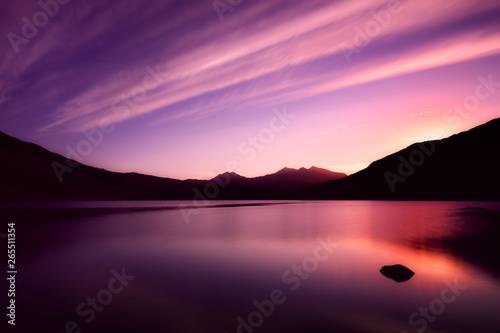 Canvas Print The lake Llynnau Mymbyr reflecting the sky, clouds and sunset with Mount Snowdon in the background