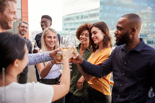 Canvas Print Creative business colleagues raising glasses and making a toast with drinks afte