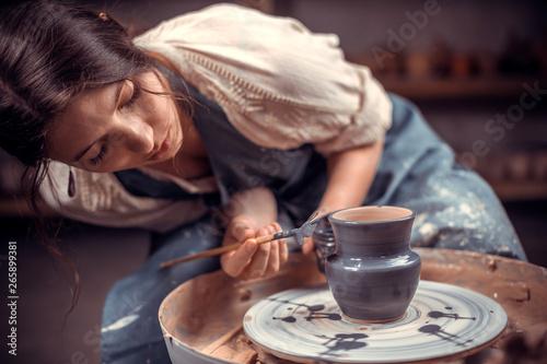 Fotografija Stylish pottery woman enjoying pottery art and production process