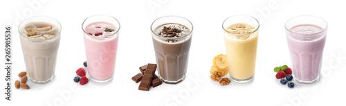 Fotografia Set of glasses with delicious protein shakes on white background