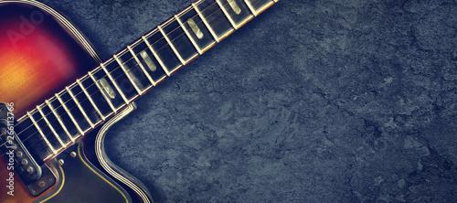 Photo Old jazz electro guitar on a dark background