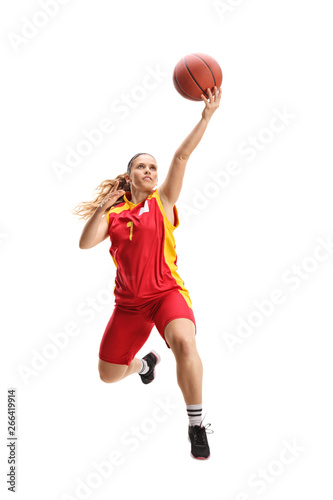 Female basketball player jumping with a ball Fototapet