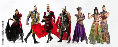 Fotografia Bright fairy tale characters in costumes in front of white background