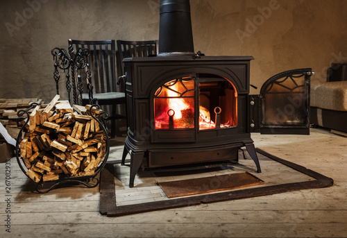 burning wood in the stove in country house Fototapeta