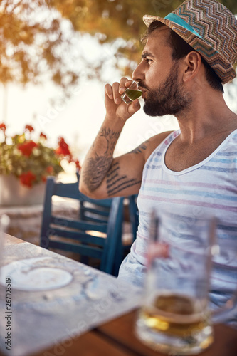 man hipster relaxes and drinking on vacation. Fototapeta