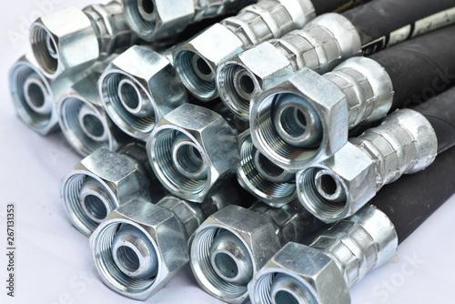 Obraz na płótnie Hydraulic industrial hoses on a white background.