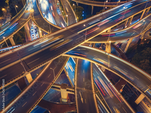 Aerial view of highway junctions shape letter x cross at night Fototapete