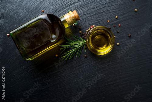 Carta da parati Virgin olive oil in a glass bottle and rosemary