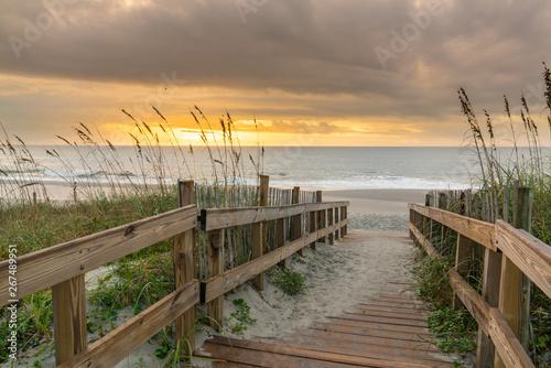 Obraz na płótnie Boardwalk Leading to the Beach at Sunrise