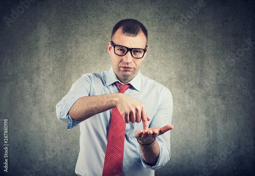 business man in glasses asking for more money Fototapeta