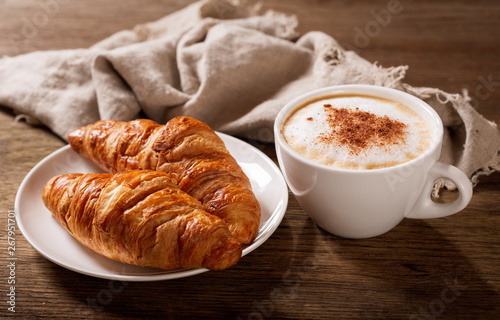 cup of cappuccino coffee and croissants Fototapet