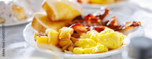 Fotografering breakfast with eggs bacon and hashbrowns panorama