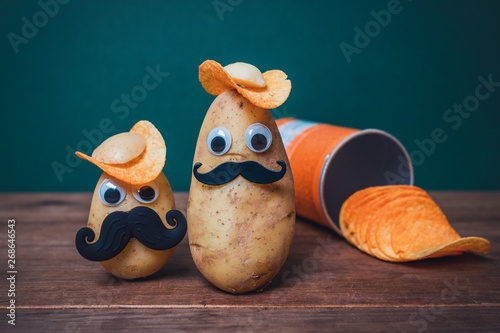 фотография funny potato head with face on wooden table