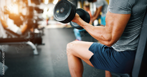 Wallpaper Mural Determined handsome and young male working out in gym