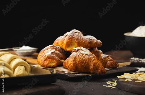 Cuadros en Lienzo Breakfast croissant with chocolate on a dark stone background