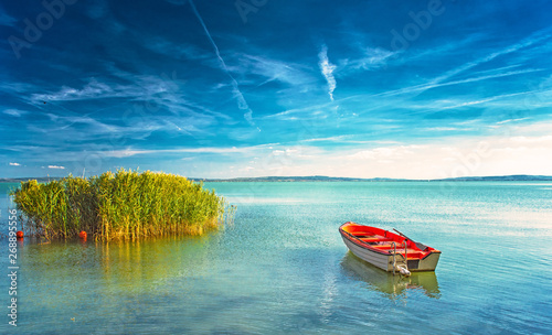 Fotografie, Obraz Lake Balaton with a red boat on a sunny day