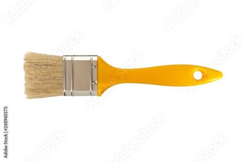 Yellow paintbrush on white Fototapeta