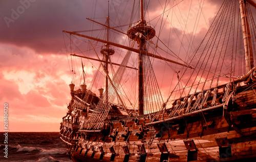 Obraz na płótnie Re-production of a galleon in public site in Genova, Italy, stormy sky