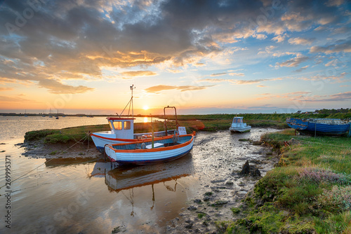 Wallpaper Mural Stunning sunset over old fishing boats