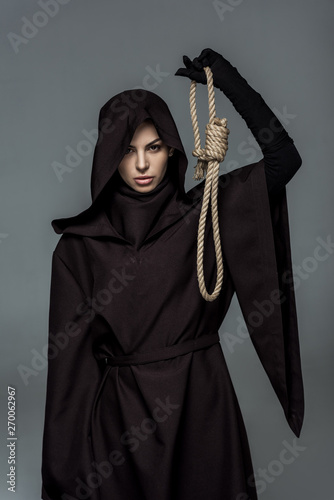 woman in death costume holding hanging noose isolated on grey Fototapeta