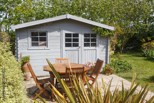 Shed with terrace and wooden garden furniture during spring Fototapeta