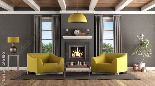 Photo Classic living room with fireplace and modern furniture