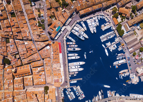 Fototapeta Center of old town Saint-Tropez and harbor from above