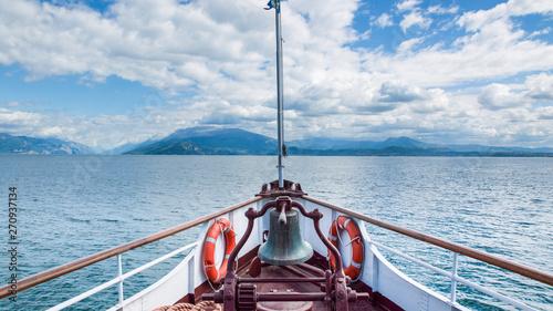 Canvas Print Sailing on a boat on Garda lake, Italy