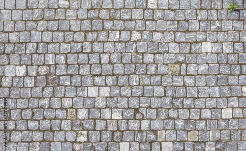 Fotografia, Obraz Closeup view on a cobblestone road.