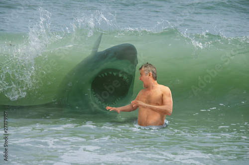 Wallpaper Mural Frightened swimmer man getting hit by wave with attacking shark