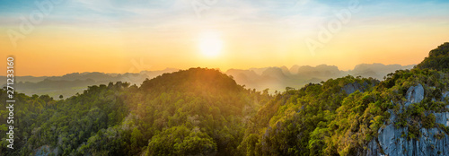 Canvas Print Panorama of tropicall landscape with dramatic sunset and steep mountain ridge on horizon