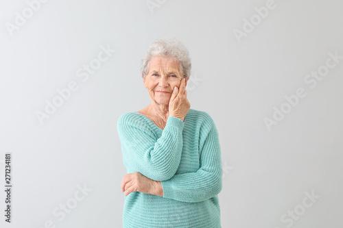 Fotografia, Obraz Portrait of senior woman on light background