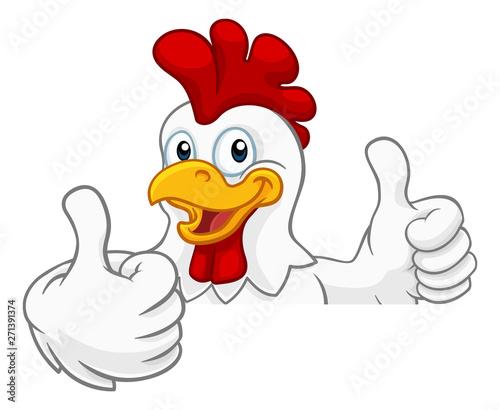 Fotografiet A chicken rooster cockerel bird cartoon character peeking over a sign and giving