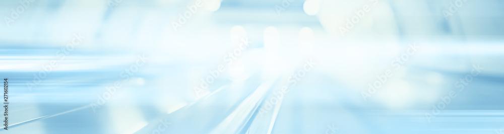 blurred background metro escalator / light blue background movement city infrastructure subway