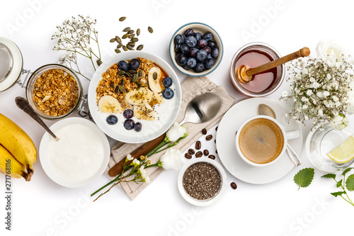 Fotografering Healthy breakfast set on white background, top view, copy space