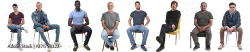 Fotografia group of mixed man sitting on chair on white background