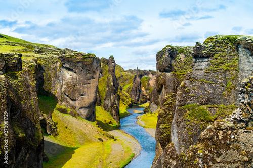 Wallpaper Mural Iceland canyon fjaðrárgljúfur with river flowing through it