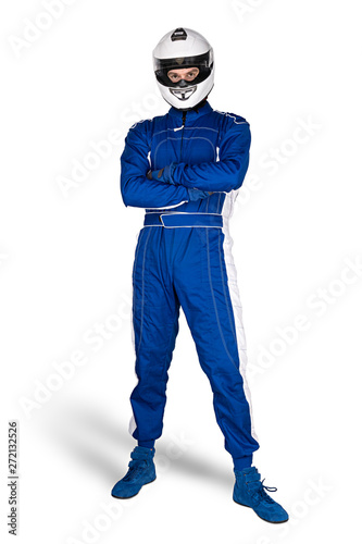 Fototapeta Determined race driver in blue white motorsport overall shoes gloves and integral safety crash helmet isolated white background